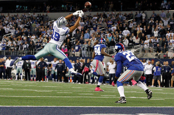 Miles Austin #19 of the Dallas Cowboys fails to pull in a game ending pass in the end zone against Corey Webster #23 of the New York Giants in the last play of the game at Cowboys Stadium on October 28, 2012 in Arlington, Texas. The New York Giants beat the Dallas Cowboys 29-24.