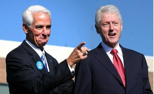 Former president Bill Clinton is welcomed to the stage by former Florida governor Charlie Crist at the University of Central Florida, Monday, October 29, 2012. President Barack Obama was scheduled to attend the rally, but had to cancel because of Hurricane Sandy's impact on the Northeast U.S. (Joe Burbank/Orlando Sentinel)