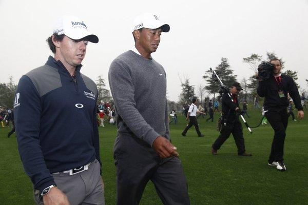 Rory McIlroy and Tiger Woods walk together during their exhibiton match on Monday in China.