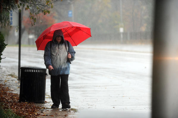 Div Brown of Baltimore walks in the rain along Northern Pkwy in Baltimore as the effects of Hurricane Sandy were felt in and around Baltimore. Brown was making nearly eight mile trek from Morgan State to Reisterstowne Square Apartments since public transportation was not running.