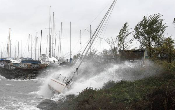 Photos: Hurricane Sandy: A sailboat smashes on the rocks after breaking free from its mooring on City Island in New York. Hurricane Sandys winds picked up speed as the storm made a left turn toward the East Coast.