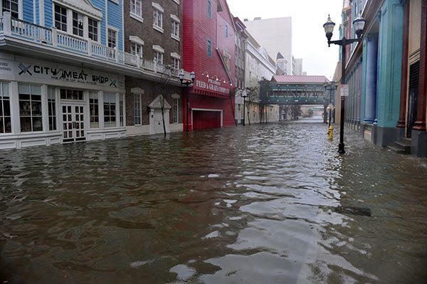 "A flooded street between two casinos along the Boardwalk before the arrival of Hurricane Sandy October 29, 2012 in Atlantic City, New Jersey  Much of the eastern United States was in lockdown mode October 29, 2012 awaiting the arrival of a hurricane dubbed ""Frankenstorm"" that threatened to wreak havoc on the area with storm surges, driving rain and devastating winds."