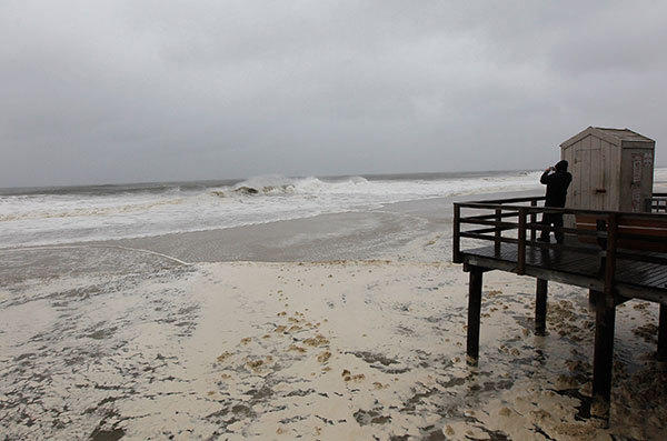 A person photographs the heavy surf from Hurricane Sandy on October 28, 2012 in Point Lookout, New York. Hurricane Sandy, which threatens 50 million people in the eastern third of the U.S., is expected to bring days of rain, high winds and possibly heavy snow to a wide area on the U.S. East Coast.