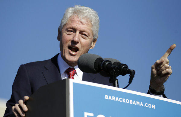 Former President Bill Clinton gestures while speaking at a campaign rally for President Obama at the University of Central Florida in Orlando, Fla.