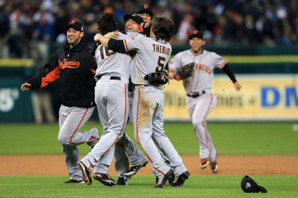 Angel Pagan, Marco Scutaro and Ryan Theriot of the San Francisco Giants celebrate with teammates after defeating the Detroit Tigers to win Game Four of the Major League Baseball World Series.