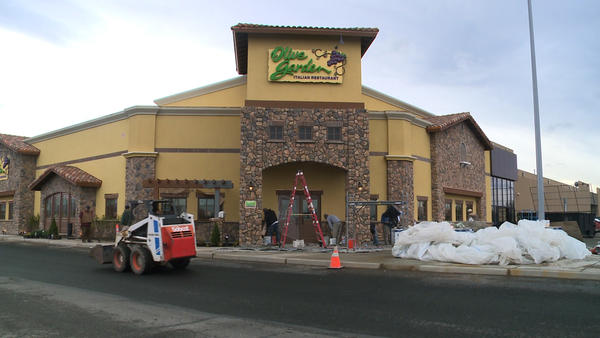 Workers put the finishing touches on the second Olive Garden in South Anchorage.