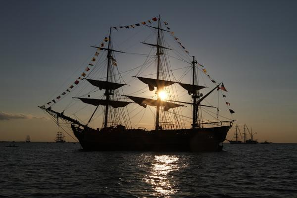 The replica tall ship HMS Bounty sits at anchor in the Chesapeake Bay at sunset in June during its visit to Hampton Roads with OpSail 2012.