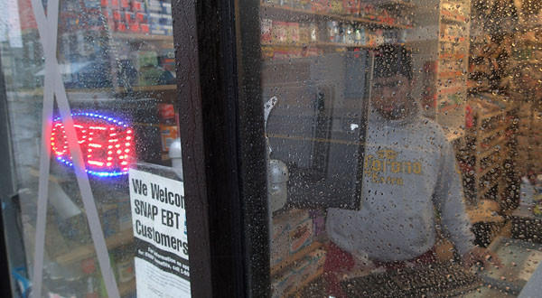 Some East Coast store owners kept doors open to help nearby residents who needed food and water with Hurricane Sandy drawing near.