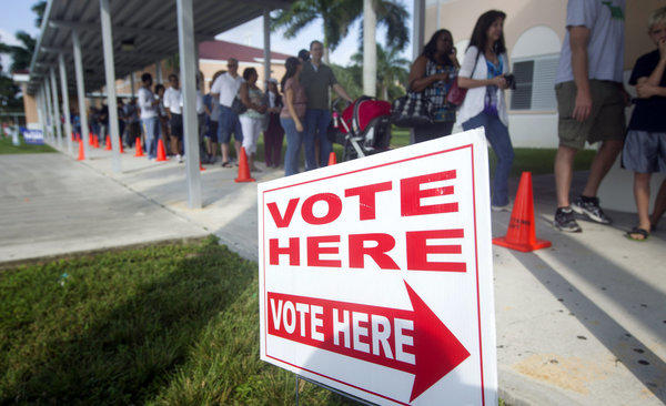People stand in line to vote early in Pembroke Pines, Fla.