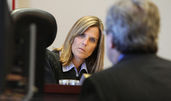 Judge Jenifer M.Davis,left. listens to Attorney Michael LaFay during a court hearing today. Lafay is asking Judge Davis to throw out key evidence in the Timothy Davis Sr. murder case.