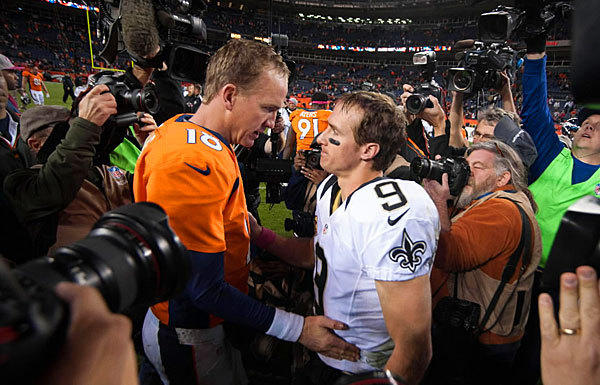 Drew Brees, right, of the New Orleans Saints congratulates Peyton Manning of the Broncos after a Sunday night game on Oct. 28  in Denver. The two quarterbacks are destined for the Hall of Fame.