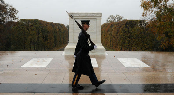 Spc. Brett Hyde keeps guard over the Tomb of the Unknown Soldier during Hurricane Sandy at Arlington National Cemetery, Va.