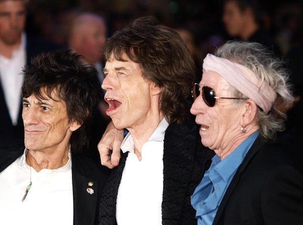 Rolling Stones guitarist Ronnie Wood, left, with Mick Jagger and Keith Richards, has sold off memorabilia in wake of his divorce from Jo Wood, his wife of 23 years.