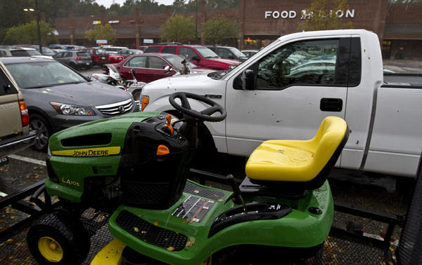 Hurricane Sandy in Poquoson,   People from Poq. park cars, cycles, RV's boats and now their John Deere lawn tractor to keep them safe for high water at this Food Lion in Poquoson.