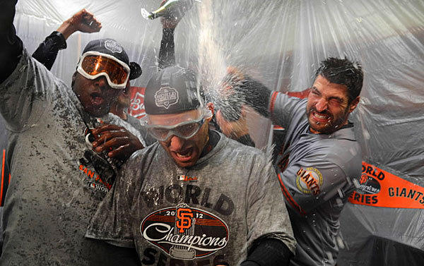 San Francisco Giants celebrate with champagne after sweeping the Detroit Tigers in four games to win the 2012 World Series.