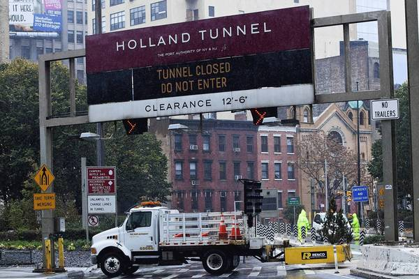 The Holland Tunnel is closed due to Hurricane Sandy in New York City. The storm, which threatens 50 million people in the eastern third of the U.S., is expected to bring days of rain, high winds and possibly heavy snow. New York Governor Andrew Cuomo announced the closure of all New York City's bus, subway and commuter rail service as of Sunday evening