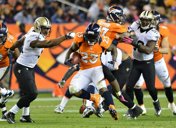 Denver Broncos running back Willis McGahee (23) runs during fourth quarter of the game against the New Orleans Saints.