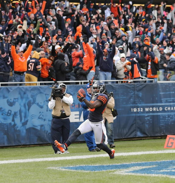 Bears fans' hearts are still racing after this nail-biter of a win over the struggling Panthers. Robbie Gould sealed the deal with a field goal, but he never would have had a chance without Tim Jennings' interception return for a TD (pictured) and heroics from Jay Cutler and the offense in the fourth quarter. RECORD: 6-1