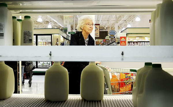 Dolly Gray of Williamsport looks for milk at the Martins Grocery on Wesel Boulevard Monday afternoon. Water and milk shelves were nearing empty as residents prepared for the storm.
