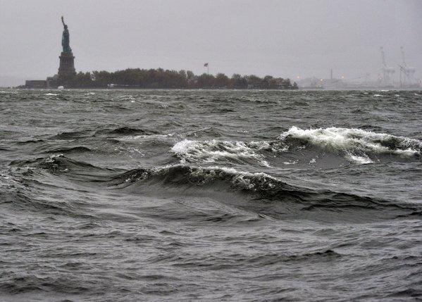 Waves kick up on Hudson River as Hurricane Sandy approaches Monday. The Statue of Liberty is in the background.