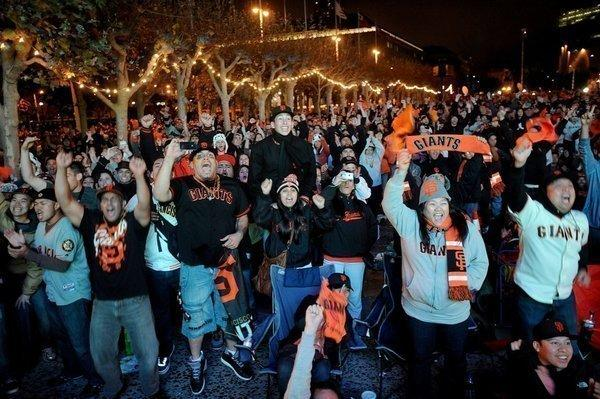 Giants fans celebrate outside San Francisco City Hall.