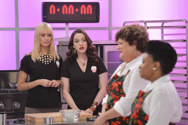 "Caroline (Beth Behrs) and Max (Kat Dennings) in ""2 Broke Girls."""