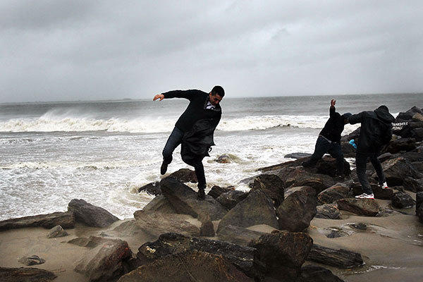 A man fights against the wind along Brighton Beach as Hurricane Sandy begins to affect the area on October 29, 2012 in the in Brooklyn borough of New York City. The storm, which threatens 50 million people in the eastern third of the U.S., is expected to bring days of rain, high winds and possibly heavy snow. New York Governor Andrew Cuomo announced the closure of all New York City will  bus, subway and commuter rail service as of Sunday evening.