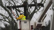 Power outages hit a plateau early Tuesday morning and began creeping downward, with about 186,000 Baltimore Gas and Electric Co. customers without electricity at noon, according to the company.