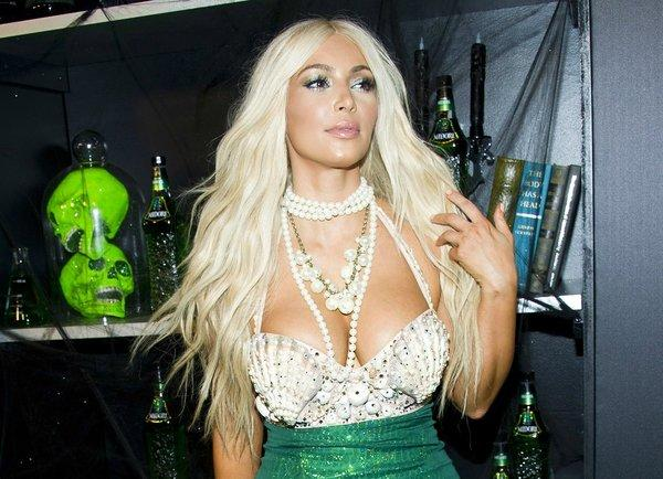 Kim Kardashian channels her inner mermaid for Midori's Halloween bash in New York on Saturday. She attended with boyfriend Kanye West.