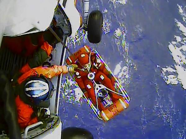 Photos: Hurricane Sandy: A frame from a video shows a crew member of the HMS Bounty being lifted to a Coast Guard rescue helicopter in a rescue basket, 90 miles southeast of Cape Hatteras, North Carolina. The Coast Guard rescued 14 people from life rafts after the ship went down in the rough seas of Hurricane Sandy.