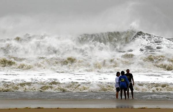 Photos: Hurricane Sandy: A wall of water makes its way to shore as residents take a dip in the big surf in Ocean City, Maryland, as Hurricane Sandy intensifies. About 50 million people from the Mid-Atlantic to Canada were in the path of the nearly 1,000-mile-wide storm, which forecasters said could be the largest to hit the mainland in U.S. history.