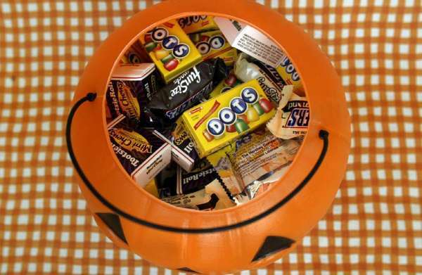 Mickey Mouse, Lightning McQueen and other Disney characters should not appear on candy packaged for Halloween and other holidays, according to nutrition experts at the Center for Science in the Public Interest.