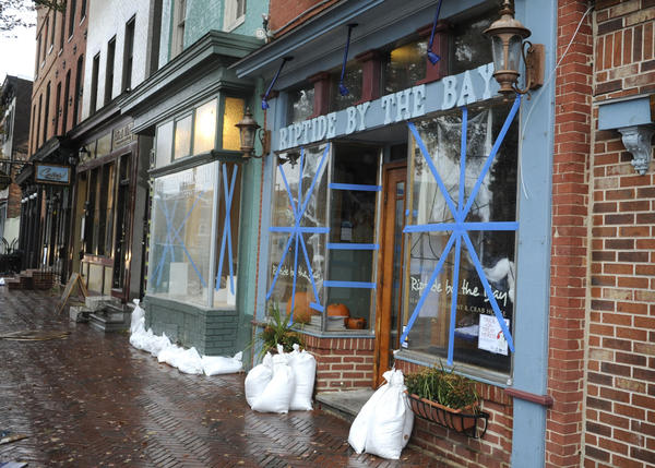 Some of the businesses along Thames Street in Fells Point are sandbagged and taped, including Riptide by the Bay.