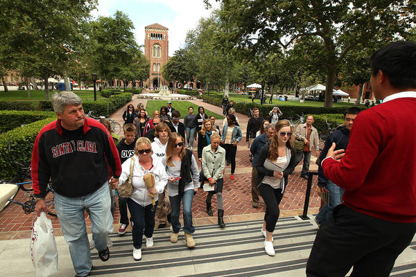 A group is seen touring the USC campus.