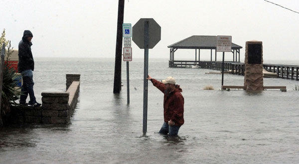 Bobby Huggins, of Millville, and his cousin, Brian Cuthbert, of Somers Point, see how deep the water is at Bay Avenue and New Jersey Avenue in Somers Point, N.J.