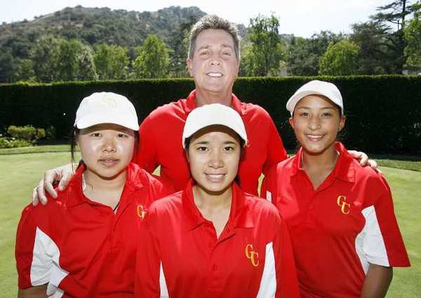 ARCHIVE PHOTO: Coach Greg Osbourne stands with Patraporn Silawanna, Vicanda Ma and Jasmine Daniel of the Glendale Community College women's golf team.