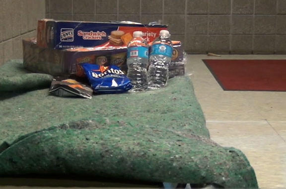 A cot with some snacks and water for those who may have to evacuate their homes is set up at a shelter opened at North Hagerstown High School. Three shelters have been opened by the Red Cross in Washington County.