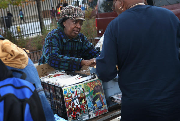Annie Smith sells comic books and CDs at the century-old Maxwell Street Market on in Chicago, Ill. The Supreme Court heard a case Monday that could decide how much control manufacturers can exert over their products after theyve been sold.