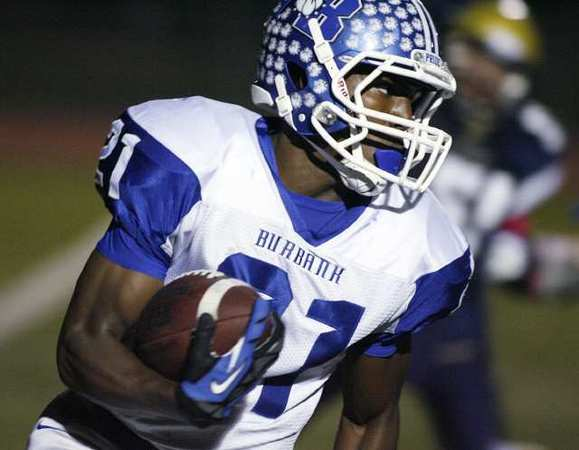 ARCHIVE PHOTO: Burbank's James Williams scored three touchdowns in last week's game against Glendale.