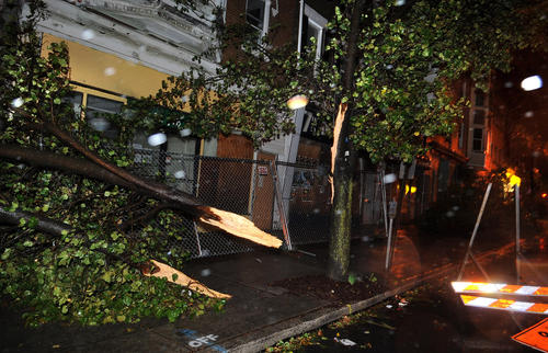 Trees are down along N. 7th Street near Linden Street in Allentown Monday night as the Lehigh Valley region is hit by high winds and rain from the storm known as Sandy.