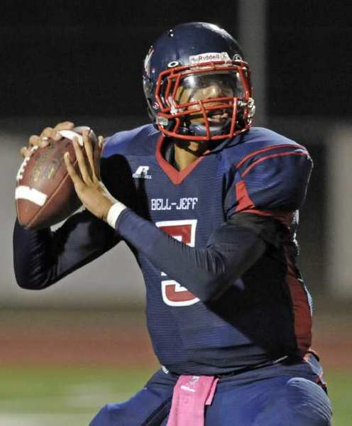 ARCHIVE PHOTO: Bell-Jeff's quarterback Jonathan Gales looks to throw downfield against Salesian.