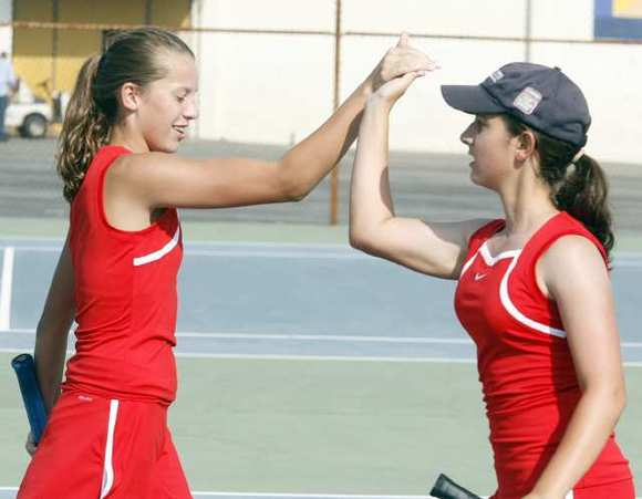 ARCHIVE PHOTO: Flintridge Sacred Heart Academy's Holly McVaugh and Nicolette Harutunian celebrate A winning point Westridge earlier this year.