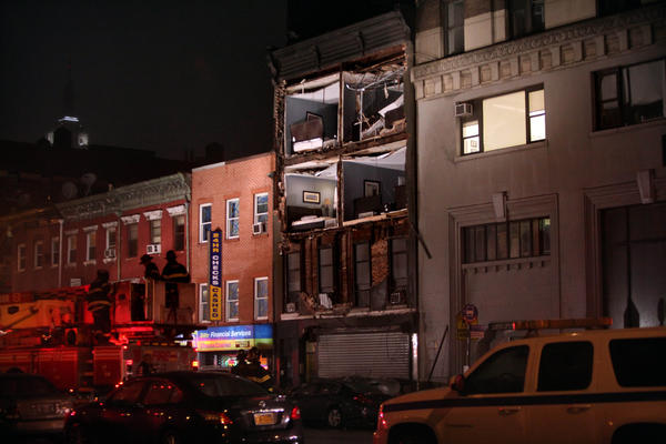 Photos: Hurricane Sandy: The facade of an apartment building collapsed in the Chelsea neighborhood of Manhattan, New York. Hurricane Sandy, which threatens 50 million people in the eastern third of the U.S., is expected to bring days of rain, high winds and possibly heavy snow.