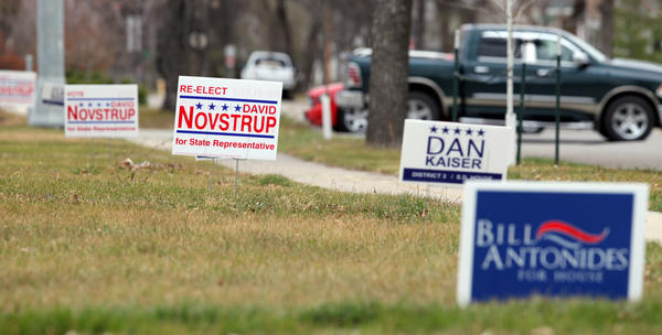 With the Nov. 6 election drawing near, political signs are popping up on area lawns like dandelions.