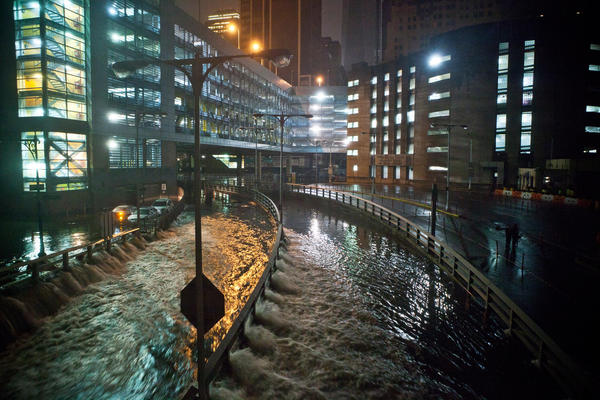 Photos: Hurricane Sandy: Water rushes into the Carey Tunnel, previously the Brooklyn Battery Tunnel, in the Financial District of New York after Superstorm Sandy hit the East Coast Monday evening.