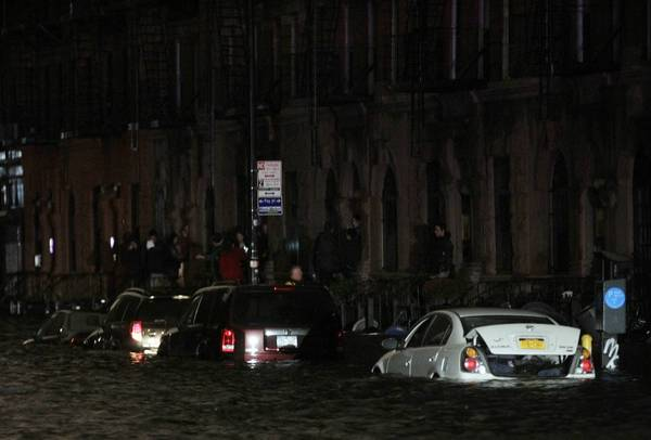 Photos: Hurricane Sandy: Flood waters brought on by Hurricane Sandy over run cars in New Yorks lower east side. Hurricane Sandy began battering the U.S. East Coast on Monday with fierce winds and driving rain, as the monster storm shut down transportation, shuttered businesses and sent thousands scrambling for higher ground hours before the worst was due to strike.