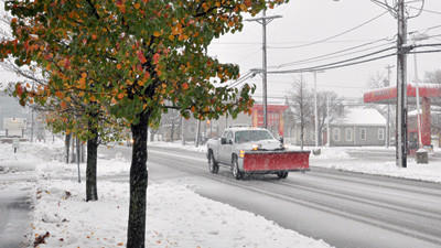 A snow plow drives down West Main Street, Somerset Tuesday morning as Hurricane Sandy continues to deliver snow and rain to the region.