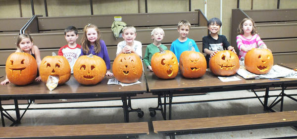 The Boyne City Elementary School 21st Century Community Learning Center program held a family pumpkin carving night Thursday, Oct. 25. Pictured are (from left) Kiersten Kenney, Odin Kirkby, Ella Seelye, Tannis Guzniczak, Luke Baker, Caiden Watkins, Jayden Hany and Emily Biskner.