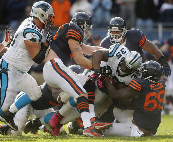 Bears defensive tackle Henry Melton (69) gets help in stopping Panthers fullback Mike Tolbert in the fourth quarter.