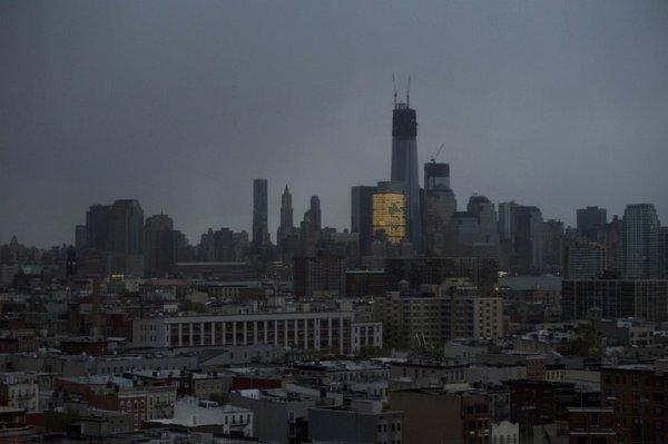 One World Trade Center and large portions of lower Manhattan and Hoboken, N.J., are seen without power from Jersey City, N.J. on Tuesday morning, the day after superstorm Sandy made landfall.